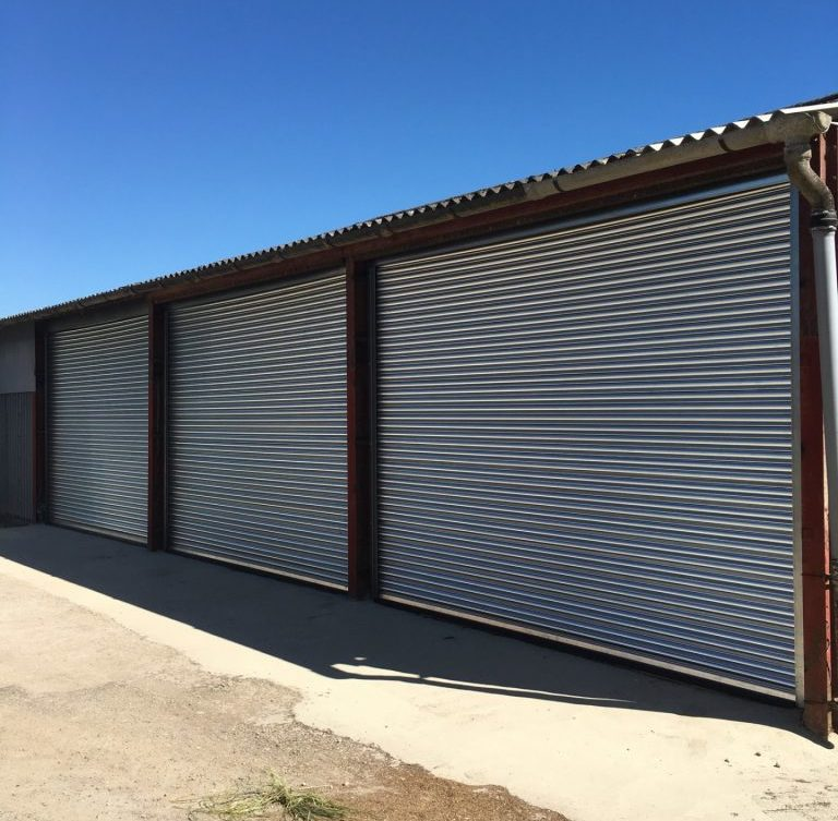 Three adjoining roller shutters installed on outdoor building