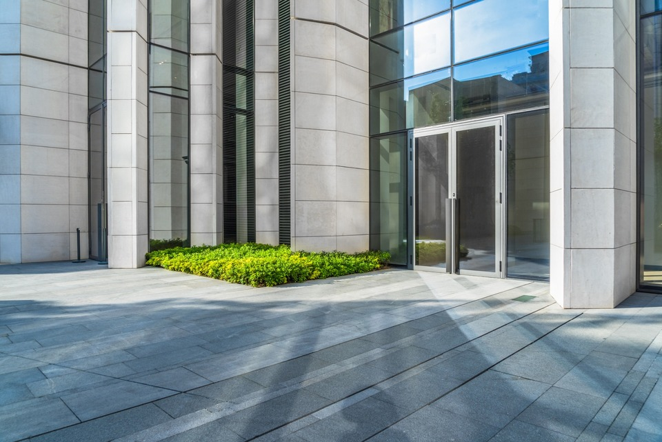Double glass doors installed on corporate building with glass windows for walls