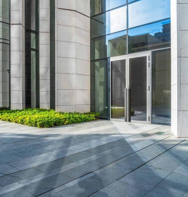 Glass door installation on corporate building