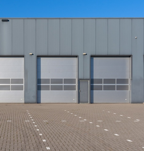 Shutter doors on warehouse for multiple delivery vehicles